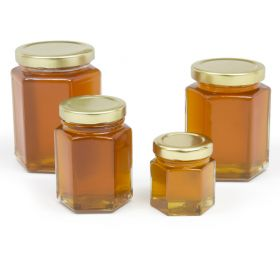 Hex shaped jars made of heavy glass. Great for  container candles, lotions, etc. Be sure to add jars AND lids to your cart