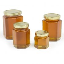 Hex shaped jars made of heavy glass. Great for specialty honey, creamed honey, honey mustards, container candles, etc. SDoes not include lids, order lids separately under same item